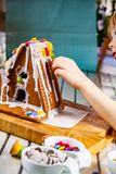 Familiy building a sweet ginger bread house royalty free stock image