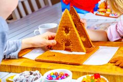 Familiy building a sweet ginger bread house stock image