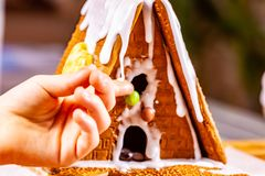 Familiy building a sweet ginger bread house royalty free stock photo