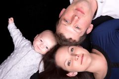 Family portrait of mother father and baby laying down Stock Photo