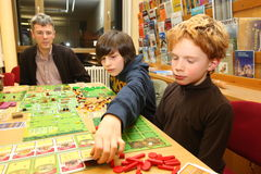 Familiy playing board game Royalty Free Stock Image
