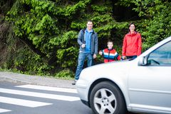 Familiy waiting by the Crosswalk Stock Image