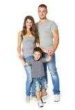 Familj över vit bakgrund, lyckliga föräldrar med barnet, tre Fotografering för Bildbyråer