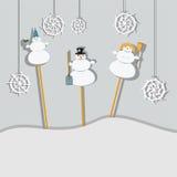 Familj av snögubbear Arkivfoton