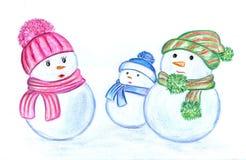 Familj av snögubbear i hattar och sharfah Arkivfoton
