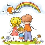 Familj bakifrån som ser regnbågen Arkivbild
