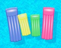 Familj för vatten för simbassäng för luftmadrasser Arkivfoton