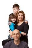 Familj från fyra folk Arkivbild