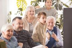 Familj framme av tv royaltyfria foton