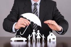 Familj-, hus- och bilförsäkringbegrepp Fotografering för Bildbyråer
