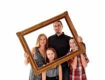 Familj i bildram arkivfoto
