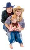 Familj i cowboydräkter Royaltyfri Bild