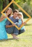 Familj i en inrama Arkivbild