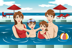 Familj i en simbassäng Arkivbild