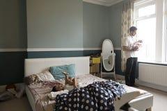 Familj i sovrummet Arkivfoto