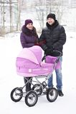 Familj med barnvagn Royaltyfria Bilder