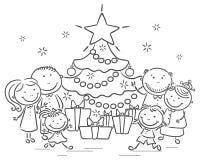 Familj med en julgran och gåvor Arkivbilder