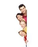 Familj med ett baner Fotografering för Bildbyråer