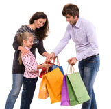 Familj med shoppingpåsar Fotografering för Bildbyråer