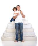 Familj och många madrasser Fotografering för Bildbyråer