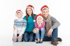 Familj på jul. Arkivbild