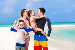 Familj på sommarsemester royaltyfria foton