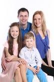 Familj på vit Fotografering för Bildbyråer