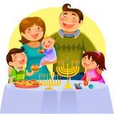 Familj som firar hanukkah arkivbild