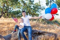 Familj som firar 4th Juli Fotografering för Bildbyråer