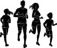 Familj som joggar i Front View Royaltyfria Bilder