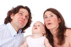 familj som upp ser barn Arkivbild