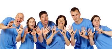 Familj som visar âWeförälskelse Familyâ på händer, Fotografering för Bildbyråer