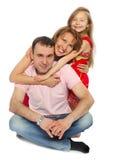Familj tre på ett golv Royaltyfri Fotografi