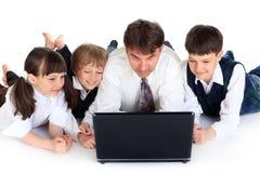 familjbärbar dator Fotografering för Bildbyråer
