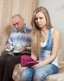Familjen grälar över pengar Royaltyfri Foto
