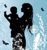 Familjen Mather och behandla som ett barn Arkivbilder