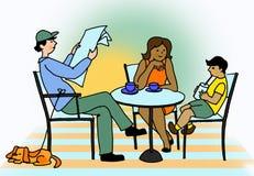 Familjfrukost i kafé Arkivbild