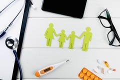 Familjhälsa och livförsäkring royaltyfri bild
