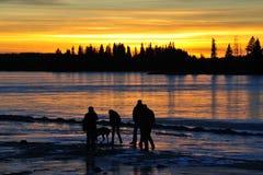 familjsolnedgång Fotografering för Bildbyråer
