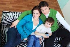 Famille à la maison Photo libre de droits