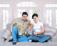 Famille à la maison Photographie stock