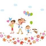 Famille à marcher en fleurs Photo stock