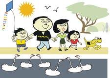 Famille asiatique dans le dessin animé de stationnement Photo stock