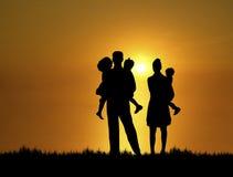 Famille au coucher du soleil 2 photo stock