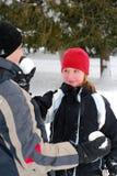 Famille avec des boules de neige Photographie stock libre de droits