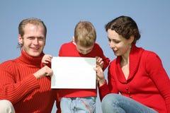 Famille avec la carte Image stock