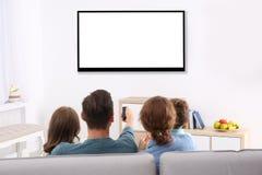 Famille avec la séance à télécommande photo libre de droits