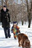 Famille avec le chien Image libre de droits