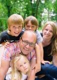 Famille avec les garçons et la fille Image libre de droits
