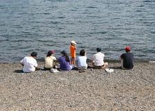 Famille d'Asain sur la plage Images libres de droits